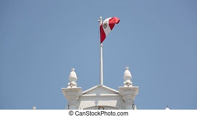 Peruvian Flag on a Colonial buildings on the main square of...