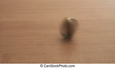 coin spinning on a table