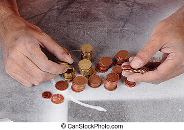 poor and coins - a poor hands taking some coins