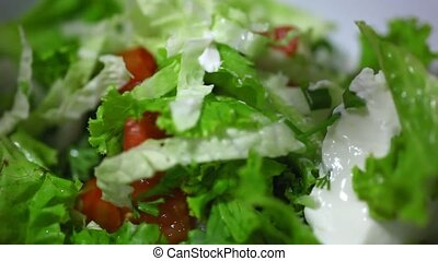 the addition of sour cream and mixing vegetable salad Video...