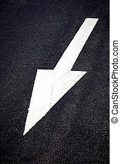 White forward traffic arrow on road