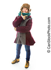 Young woman in warm clothing and showing smiley face -...