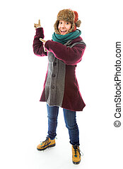Young woman in warm clothing and pointing backward -...