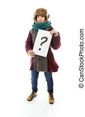 Young woman in warm clothing and showing question mark on...