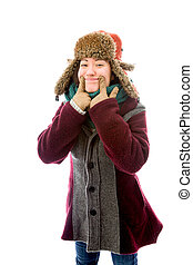 Young woman in warm clothing and showing smiley face - Young...