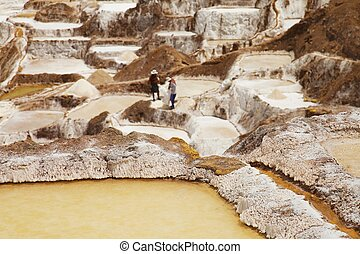 Detail of Salt ponds with people in the background, Maras,...