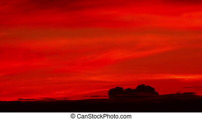 Red sunset clouds timelapse - Dramatic red sunset clouds...