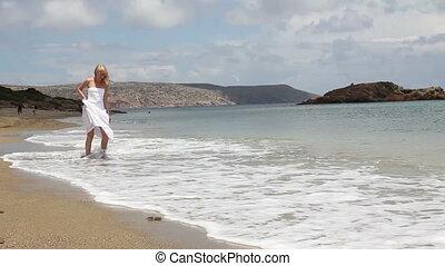 woman at the shore of sea