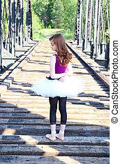 Ballet girl - Beautiful girl wearing a white tutu standing...