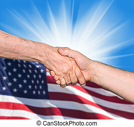 Shaking hands of two male people - The USA flag and shaking...