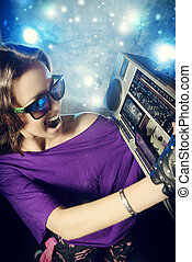 boombox - Portrait of a modern girl with tape recorder over...