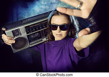 cool girl - Portrait of a modern girl with tape recorder...