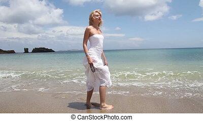 beautiful woman posing at  shore of the sea