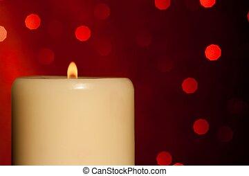 half candle with flame on wood table, christmas theme - half...