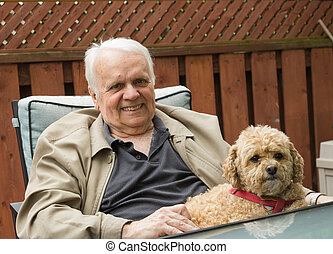 Elderly Man and Dog - Elderly Man sitting down with his dog