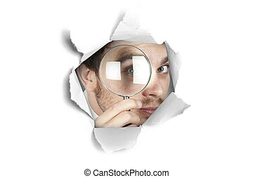 Businessman looking through a paper hole - Concept of...