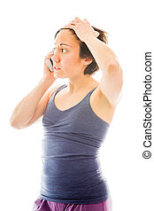 Young woman talking on mobile phone looking sad - young...