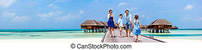 Family on summer vacation - Happy beautiful family walking...