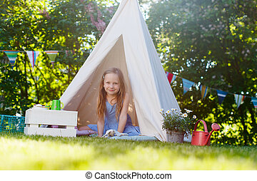 Summertime fun - Adorable little girl having fun playing in...