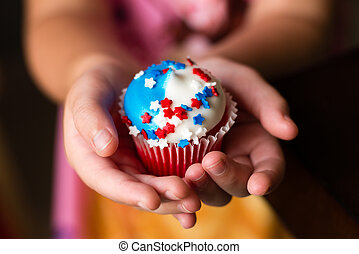 Fourth of July Star Cupcakes - A child holding a Fourth of...
