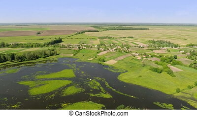 Village with a bird's-eye view - Aerial shot: Village with a...