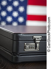 Leather Briefcase Resting on Table with American Flag Behind