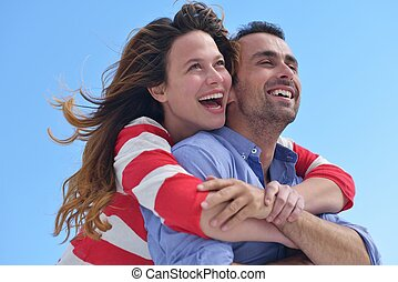 happy young romantic couple have fun relax smile at modern...