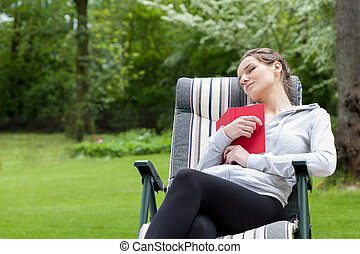 Relaxation with book - Horizontal view of a relaxation with...