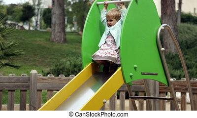 baby girl  on slide