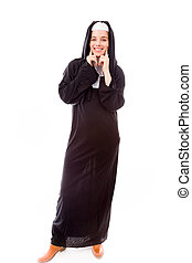 Young nun showing smiley face - Young adult caucasian woman...