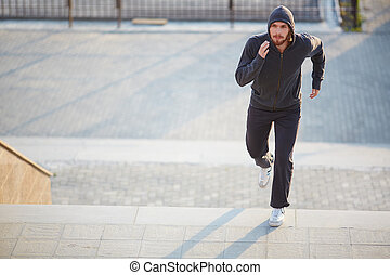 Sportsman running - Portrait of young attractive sportsman...