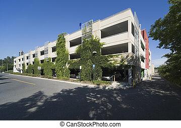 Parking garage - Modern parking garage with greenery growing...