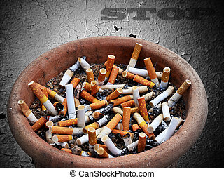 Stop Cigarette addiction - Cigarette addiction in ashtray on...
