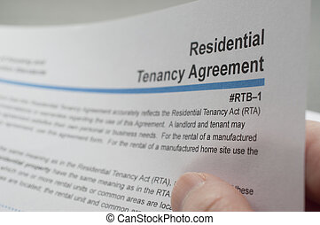 Reading residential tenancy agreement - Close up woman...
