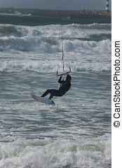 Kitesurfing or flysurfing. Silhouette of kitesurfer in the...