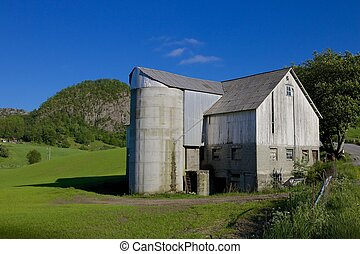 Norwegian Grain Silo 006 - Old grain silo and barn next to a...