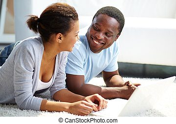 Happy time - Image of young African couple spending free...