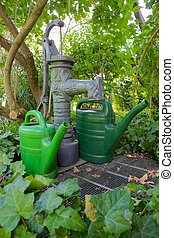 Pump well and watering cans 01 - Traditional pump well with...