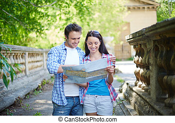 Travelers with map - Portrait of travelers with map visiting...