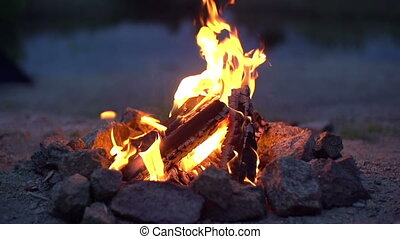Abandoned Fireside - Close up of campfire burning in slow...