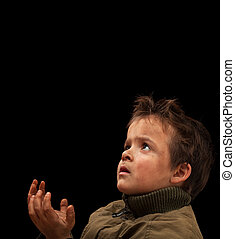 Poor child waiting for a donation - on black background
