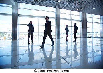 Business people in office - Several office workers on...