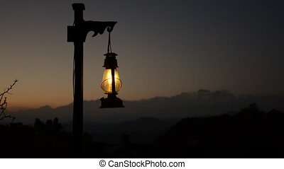 Lantern at twilight, mountain in the background