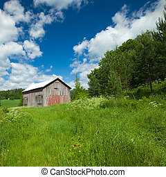 Finnish summer landscape with old barn