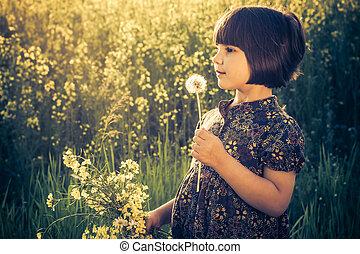 Little girl dandelions field rape bouquet - Little girl with...
