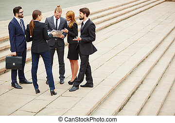 Discussion - Group of business people discussing ideas at...
