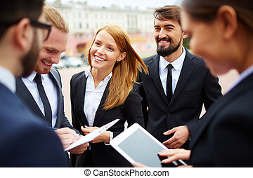 Planning work - Group of business people discussing ideas at...