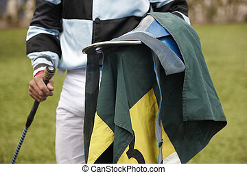 Jockey with equipment in the ground. Horizontal