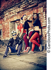 hip-hop band - Group of young modern people posing together...
