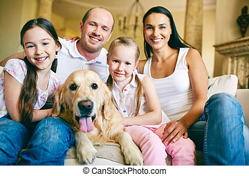 Affectionate family - A young friendly family of four with...